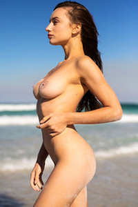 Gloria Sol is to shy to show off her nice pair of boobs while posing on the sandy beach