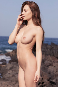 Magnificent female stuns everyone with her seductive body as she poses seaside