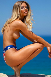 Dazzling blondie beauty removing swimsuit to present her slim figure