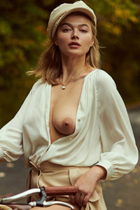 Blossoming blonde beauty elegantly showing off her natural boobs and round booty