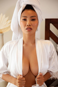 Busty Asian model takes off bathrobe baring her smoking hot curves