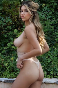 Glorious model Gina bares her boobs and ass after taking off lingerie