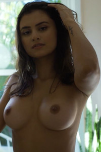 Smoking hot debutante gently revealing and flaunting her body with a pair of perfect boobs