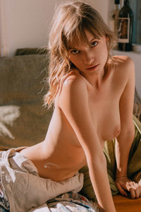 Artistic damsel evocatively posing for our delight as she undresses